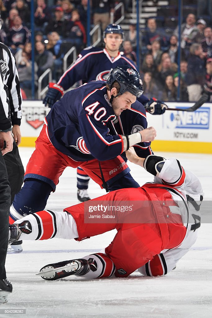 Jared Boll of the Columbus Blue Jackets fights with Brad Malone of the Carolina Hurricanes during the first period of a game on January 9 2016 at...