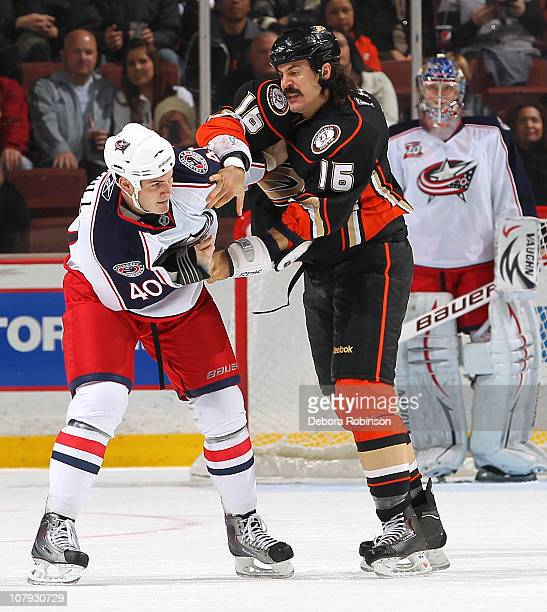 Jared Boll of the Columbus Blue Jackets fights with George Parros of the Anaheim Ducks in the first period during the game on January 7 2011 at Honda...