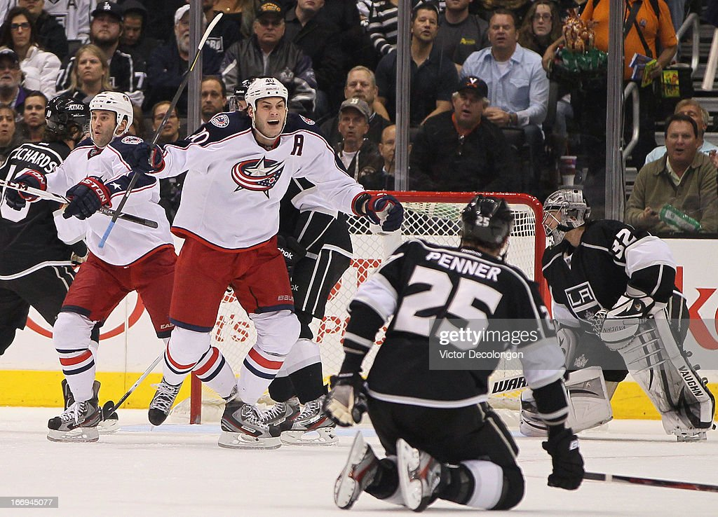 Jared Boll #40 of the Columbus Blue Jackets reacts to a goal scored by teammate Dalton Prout #47 (not in photo) in the second period as goaltender Jonathan Quick #32 and Dustin Penner #25 of the Los Angeles Kings look on during the NHL game at Staples Center on April 18, 2013 in Los Angeles, California.