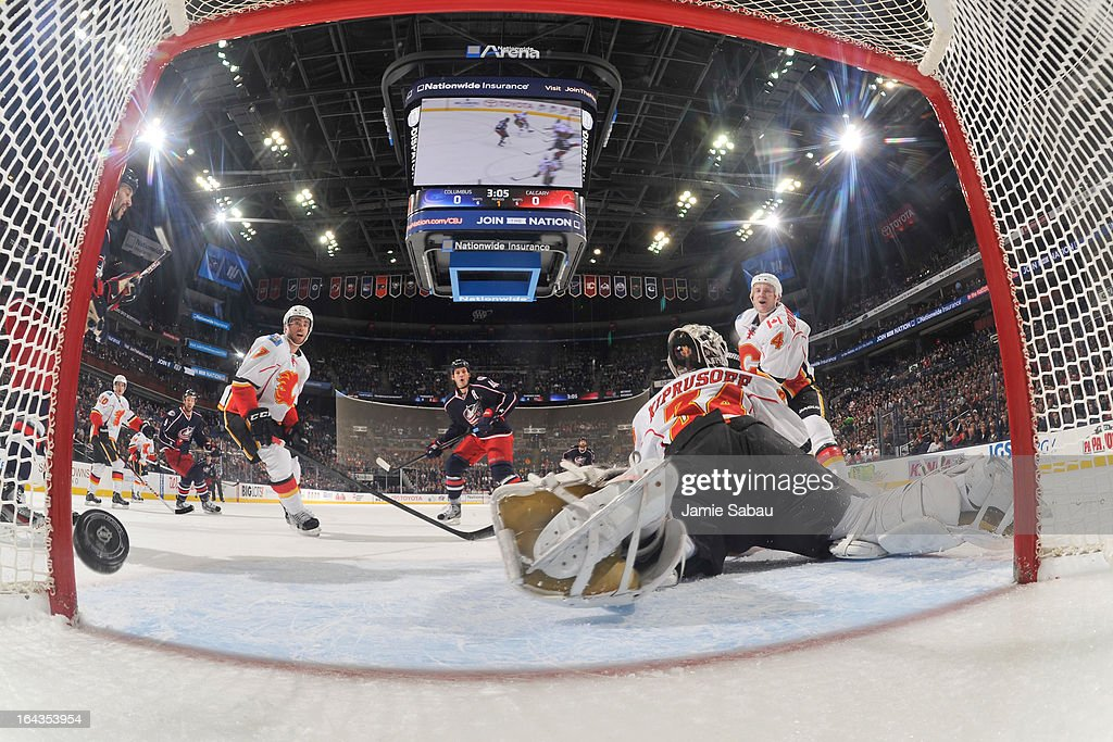 <a gi-track='captionPersonalityLinkClicked' href=/galleries/search?phrase=Jared+Boll&family=editorial&specificpeople=2238879 ng-click='$event.stopPropagation()'>Jared Boll</a> #40 of the Columbus Blue Jackets scores a goal on goaltender <a gi-track='captionPersonalityLinkClicked' href=/galleries/search?phrase=Miikka+Kiprusoff&family=editorial&specificpeople=171703 ng-click='$event.stopPropagation()'>Miikka Kiprusoff</a> #34 of the Calgary Flames in the first period on March 22, 2013 at Nationwide Arena in Columbus, Ohio.