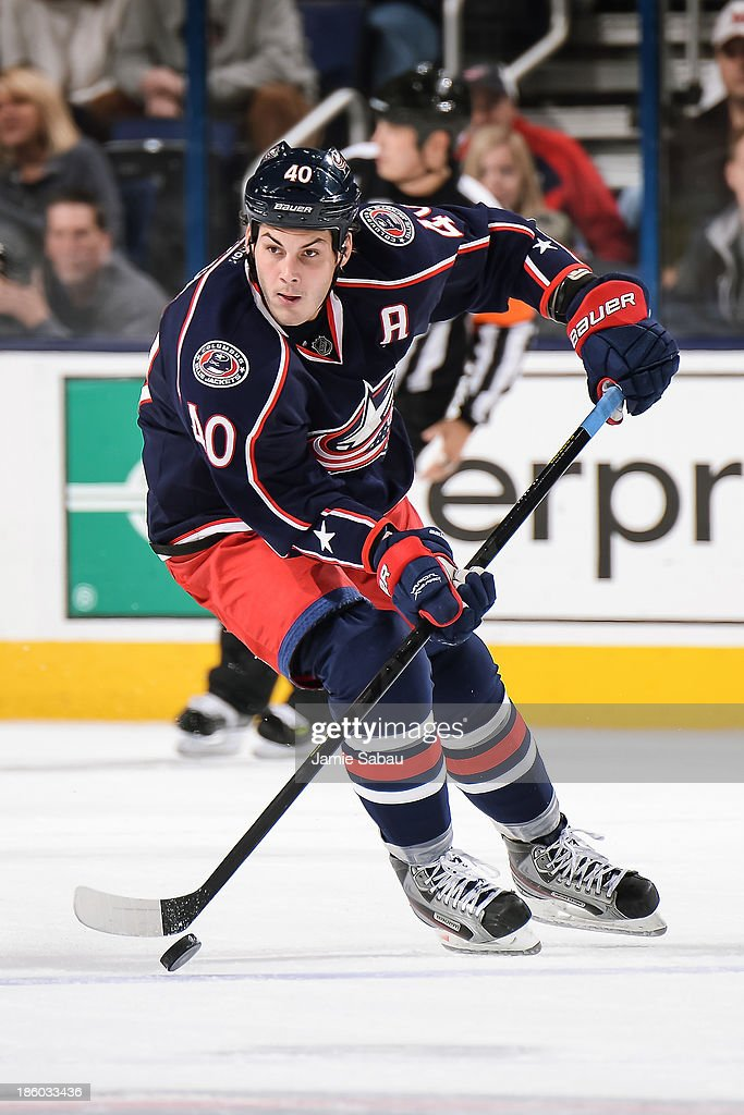 Jared Boll of the Columbus Blue Jackets skates with the puck against the New Jersey Devils on October 22 2013 at Nationwide Arena in Columbus Ohio