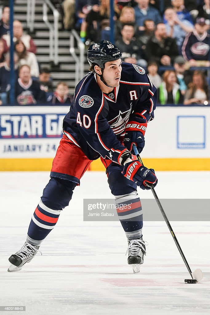 Jared Boll of the Columbus Blue Jackets skates with the puck against the Colorado Avalanche on April 1 2014 at Nationwide Arena in Columbus Ohio...