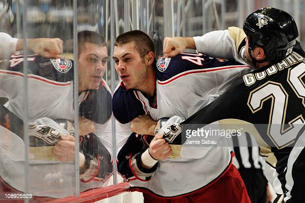 Jared Boll of the Columbus Blue Jackets takes a punch from Eric Godard of the Pittsburgh Penguins during a third period fight on February 8 2011 at...