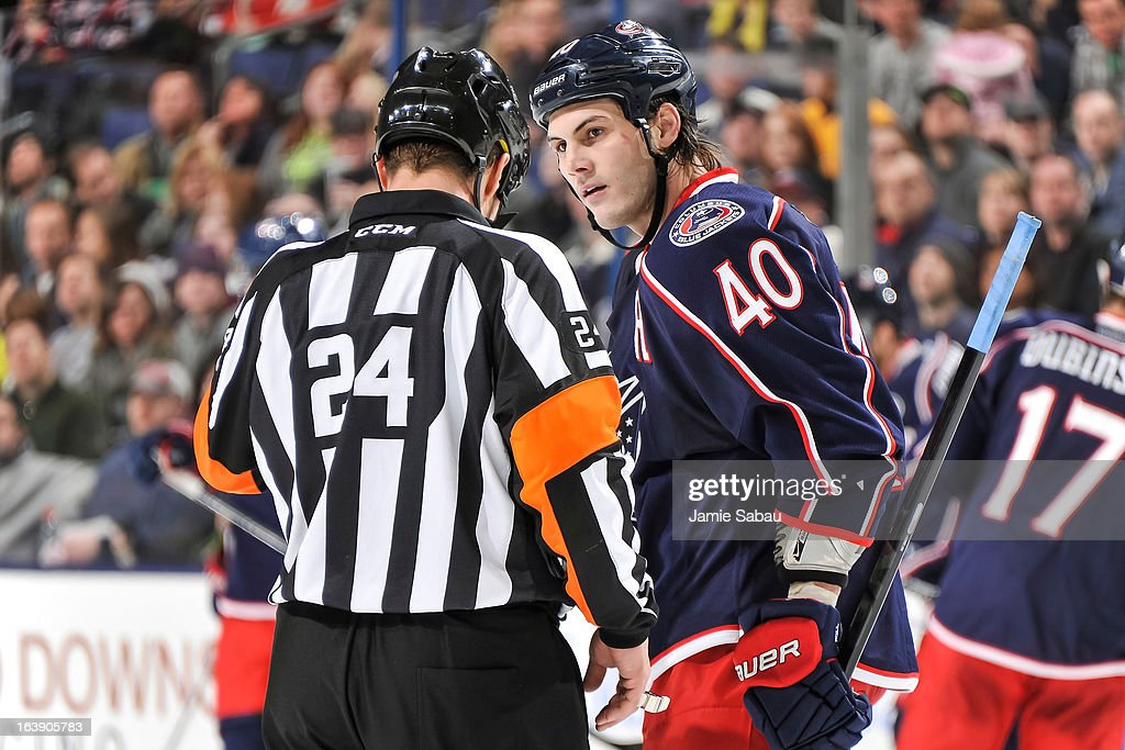 Jared Boll #40 of the Columbus Blue Jackets talks with referee Stephen Walkom #24 during a game against the Phoenix Coyotes on March 16, 2013 at Nationwide Arena in Columbus, Ohio.