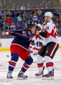 Jared Boll of the Columbus Blue Jackets throws a punch during a fight with Matt Kassian of the Ottawa Senators on November 5 2013 at Nationwide Arena...
