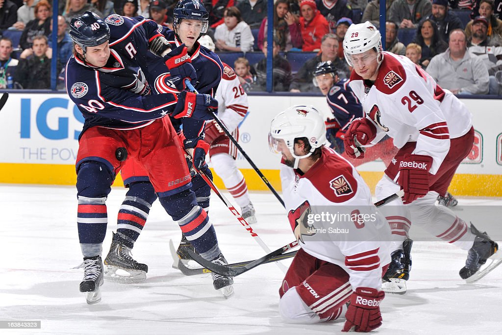Jared Boll #40 of the Columbus Blue Jackets traps the puck with his legs while battling with David Schlemko #6 of the Phoenix Coyotes during the third period on March 16, 2013 at Nationwide Arena in Columbus, Ohio. Columbus defeated Phoenix 1-0 in a shootout.