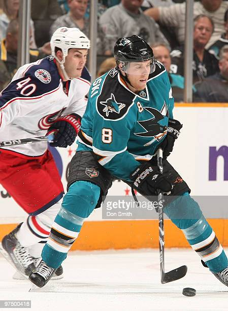 Jared Boll of the Columbus Blue Jackets watches the puck against Joe Pavelski of the San Jose Sharks during an NHL game on March 6 2010 at HP...