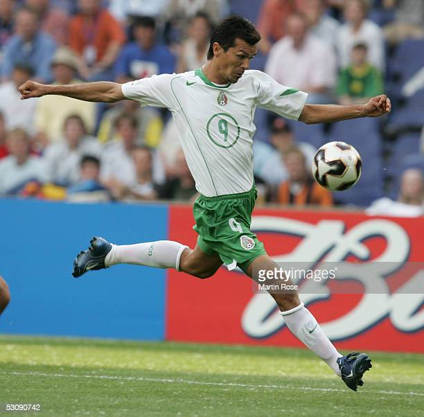 Jared Borgetti of Mexico shoot at goal during the FIFA Confederations Cup Match between Japan and Mexico at the AWD Arena on June 16 2005 in Hanover...