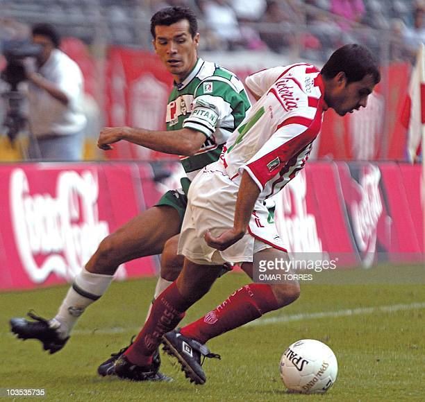 Jared Borgetti of the Santos Laguna team fights Salvador Cabrera of Necaxa for the ball 17 February 2002 in the Azteca stadium in Mexico City Jared...
