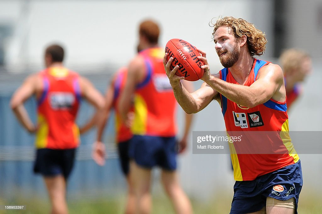 <a gi-track='captionPersonalityLinkClicked' href=/galleries/search?phrase=Jared+Brennan&family=editorial&specificpeople=220502 ng-click='$event.stopPropagation()'>Jared Brennan</a> marks during a Gold Coast Suns pre-season AFL training session at Metricon Stadium on November 26, 2012 on the Gold Coast, Australia.
