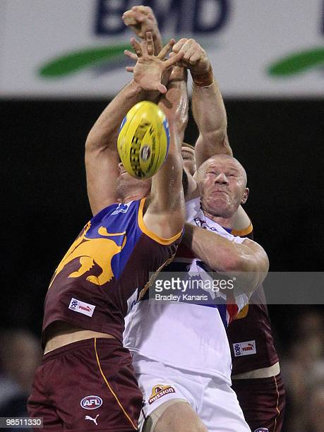 Jared Brennan of the Lions and Barry Hall of the Bulldogs compete for the ball during the round four AFL match between the Brisbane Lions and the...