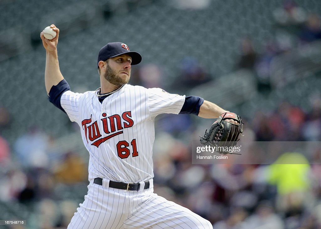 Jared Burton #61 of the Minnesota Twins delivers a pitch against the Miami Marlins during the first game of a doubleheader on April 23, 2013 at Target Field in Minneapolis, Minnesota.