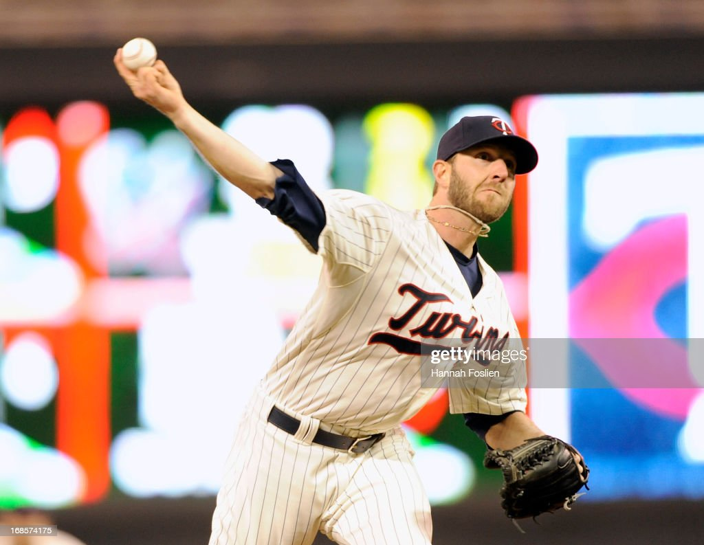 Jared Burton #61 of the Minnesota Twins delivers a pitch during the ninth inning of the game on May 11, 2013 at Target Field in Minneapolis, Minnesota. The Twins defeated the Orioles 8-5.
