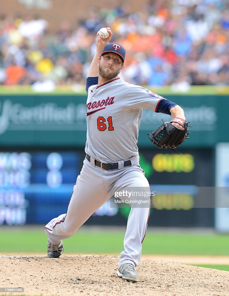 Jared Burton #61 of the Minnesota Twins pitches during the game against the Detroit Tigers at Comerica Park on August 22, 2013 in Detroit, Michigan. The Twins defeated the Tigers 7-6.