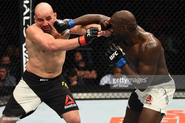 Jared Cannonier kicks Glover Teixeira of Brazil in their light heavyweight bout during the UFC 208 event inside Barclays Center on February 11 2017...