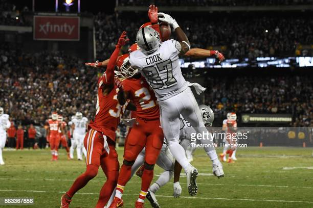 Jared Cook of the Oakland Raiders makes a catch at the oneyard line of the Kansas City Chiefs in the final moments of their NFL game at...