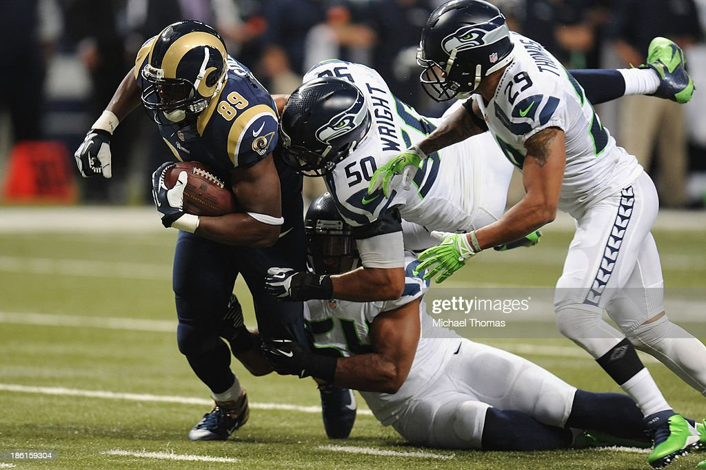 <a gi-track='captionPersonalityLinkClicked' href=/galleries/search?phrase=Jared+Cook&family=editorial&specificpeople=4483944 ng-click='$event.stopPropagation()'>Jared Cook</a> #89 of the St. Louis Rams is tackled by K.J. Wright #50 and <a gi-track='captionPersonalityLinkClicked' href=/galleries/search?phrase=Bobby+Wagner+-+American+Football+Player&family=editorial&specificpeople=9205520 ng-click='$event.stopPropagation()'>Bobby Wagner</a> #54 of the Seattle Seahawks in the fourth quarter at the Edward Jones Dome on October 28, 2013 in St. Louis, Missouri.