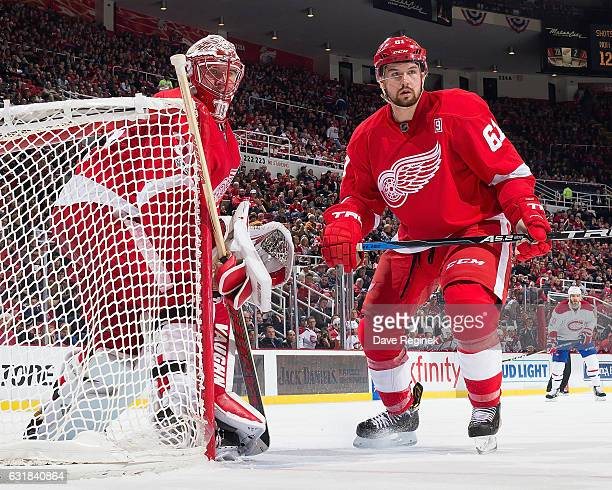 Jared Coreau and Xavier Ouellet of the Detroit Red Wings follow the play during an NHL game against the Montreal Canadiens at Joe Louis Arena on...
