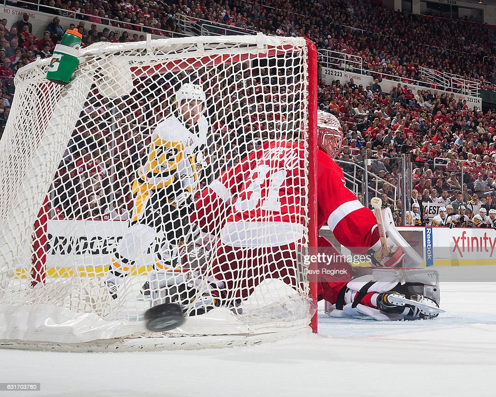 Jared Coreau #31 of the Detroit Red Wings looks as the puck is shot wide of the goal while Patric Hornqvist #72 of the Pittsburgh Penguins posts in front during an NHL game at Joe Louis Arena on January 14, 2017 in Detroit, Michigan.