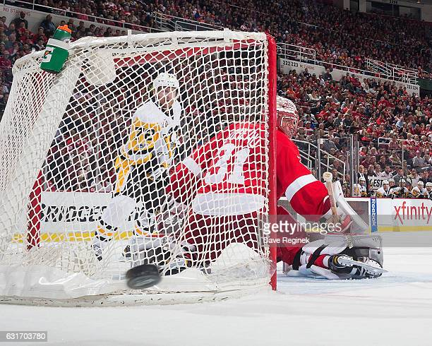 Jared Coreau of the Detroit Red Wings looks as the puck is shot wide of the goal while Patric Hornqvist of the Pittsburgh Penguins posts in front...