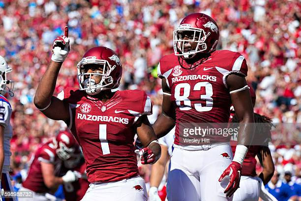 Jared Cornelius and Jeremy Sprinkle of the Arkansas Razorbacks celebrate after a touchdown during a game against the Louisiana Tech Bulldogs at...