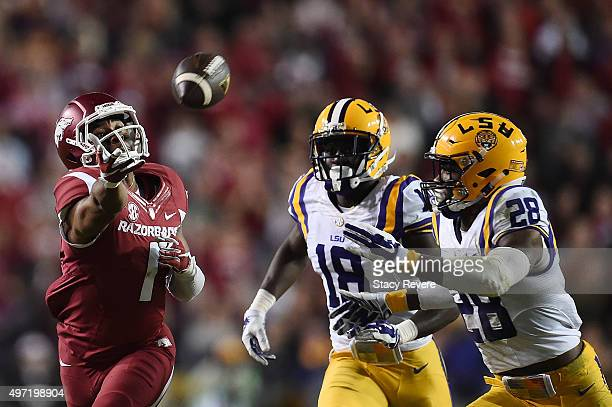 Jared Cornelius of the Arkansas Razorbacks is defended by Tre'Davious White and Jalen Mills of the LSU Tigers during a game at Tiger Stadium on...