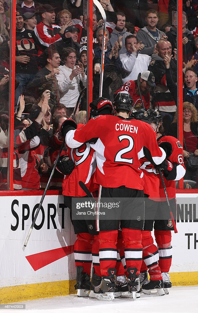 Jared Cowen #2, Erik Karlsson #65 and Jason Spezza #19 of the Ottawa Senators celebrate a third period game winning goal against the Buffalo Sabres during an NHL game at Canadian Tire Centre on February 6, 2014 in Ottawa, Ontario, Canada.