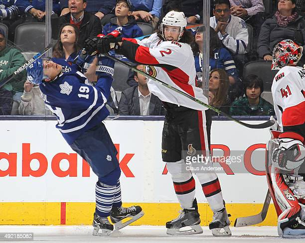 Jared Cowen of the Ottawa Senators belts Joffrey Lupul of the Toronto Maple Leafs during an NHL game at the Air Canada Centre on October 10 2015 in...