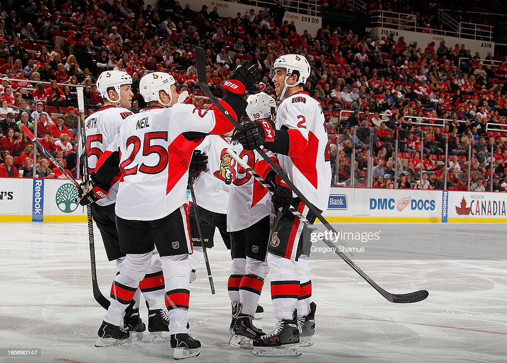 <a gi-track='captionPersonalityLinkClicked' href=/galleries/search?phrase=Jared+Cowen&family=editorial&specificpeople=4594191 ng-click='$event.stopPropagation()'>Jared Cowen</a> #2 of the Ottawa Senators celebrates his third period goal with Chris Neil #25 and Zack Smith #15 while playing the Detroit Red Wings at Joe Louis Arena on October 23, 2013 in Detroit, Michigan. Ottawa won the game 6-1.