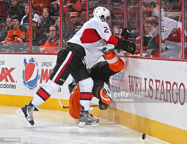 Jared Cowen of the Ottawa Senators checks Scott Hartnell of the Philadelphia Flyers to the ice on January 7 2012 at the Wells Fargo Center in...