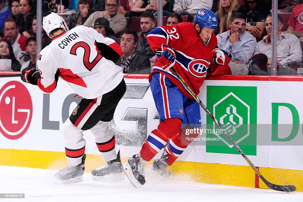 <a gi-track='captionPersonalityLinkClicked' href=/galleries/search?phrase=Jared+Cowen&family=editorial&specificpeople=4594191 ng-click='$event.stopPropagation()'>Jared Cowen</a> #2 of the Ottawa Senators sends <a gi-track='captionPersonalityLinkClicked' href=/galleries/search?phrase=Travis+Moen&family=editorial&specificpeople=208110 ng-click='$event.stopPropagation()'>Travis Moen</a> #32 of the Montreal Canadiens into the boards during an NHL preseason game at the Bell Centre on September 26, 2013 in Montreal, Quebec, Canada.