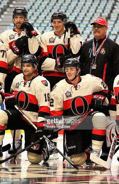 Jared Cowen Patrick Wiercioch and head coach Paul MacLean Clarke MacArthur and Erik Condra of the Ottawa Senators pose for the team picture before...