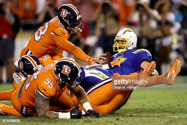 Jared Crick Derek Wolfe and Von Miller of the Denver Broncos tackle Philip Rivers of the San Diego Chargers during the second half of a game at...