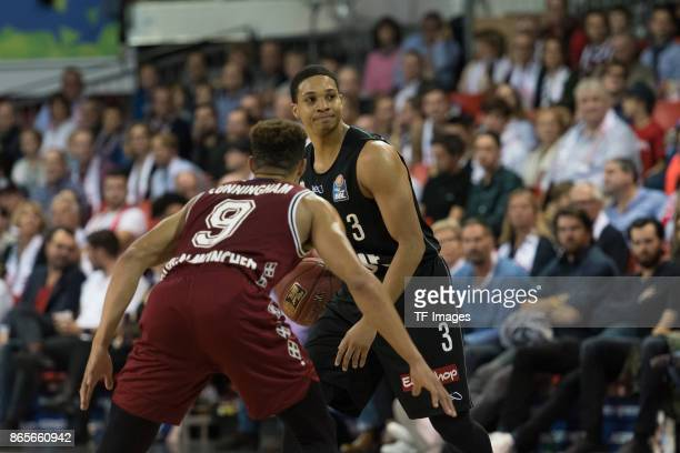 Jared Cunningham of Bayern Muenchen and Abdul Gaddy of Wuerzburg battle for the ball during the easyCredit BBL Basketball Bundesliga match between FC...