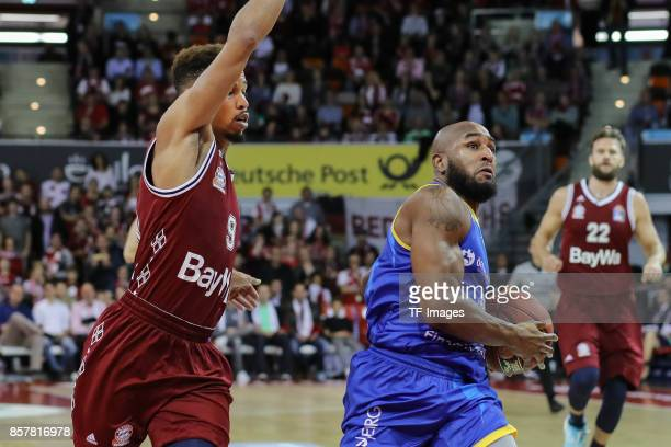Jared Cunningham of Bayern Muenchen and DeAndre Lansdowne of Braunschweig battle for the ball during the easyCredit BBL Basketball Bundesliga match...