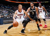 Jared Cunningham of the Atlanta Hawks against Marco Belinelli of the San Antonio Spurs at Philips Arena on October 17 2013 in Atlanta Georgia NOTE TO...