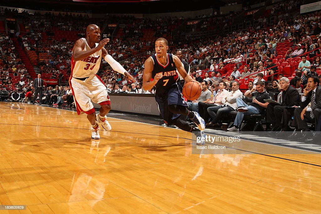Jared Cunningham #7 of the Atlanta Hawks drives to the basket against the Miami Heat during a game on October 7, 2013 at American Airlines Arena in Miami, Florida.