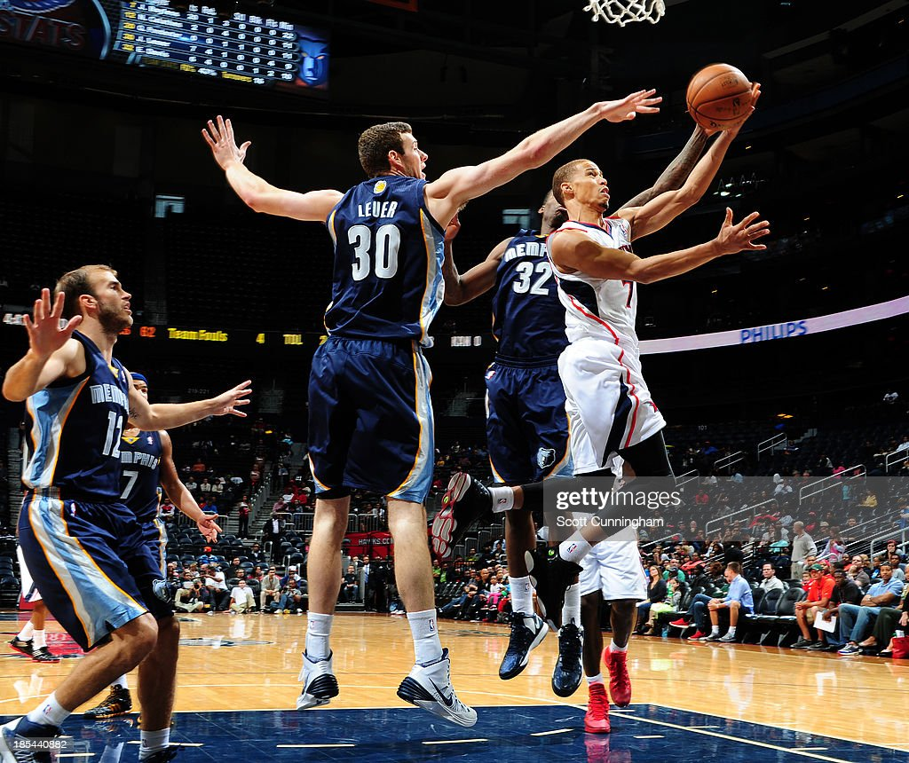 Jared Cunningham #7 of the Atlanta Hawks goes up for the shot against the Memphis Grizzlies on October 20, 2013 at Philips Arena in Atlanta, Georgia.