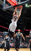 Jared Cunningham of the Atlanta Hawks reverse dunks against the San Antonio Spurs on October 17 2013 at Philips Arena in Atlanta Georgia NOTE TO USER...