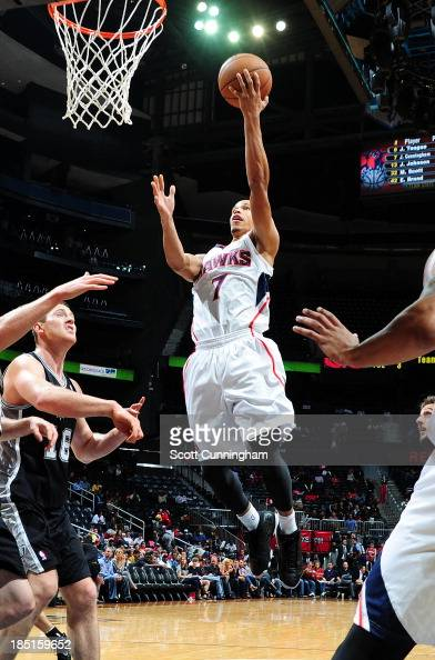Jared Cunningham of the Atlanta Hawks shoots against the San Antonio Spurs on October 17 2013 at Philips Arena in Atlanta Georgia NOTE TO USER User...