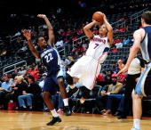 Jared Cunningham of the Atlanta Hawks shoots the jumper against the Memphis Grizzlies on October 20 2013 at Philips Arena in Atlanta Georgia NOTE TO...