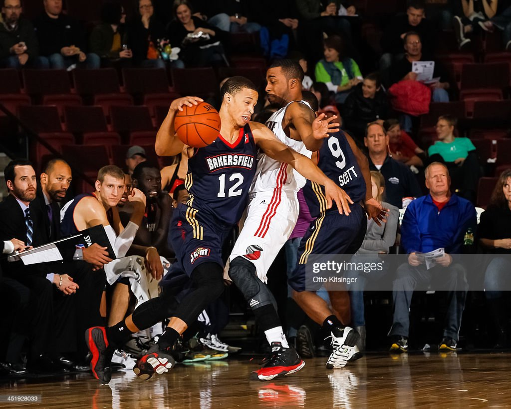 Jared Cunningham #12 of the Bakersfield Jam drives the ball against Reggie Hamilton #23 of the Idaho Stampede during an NBA D-League game on November 22, 2013 at CenturyLink Arena in Boise, Idaho. Cunningham was on assignment from the Atlanta Hawks.