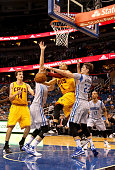 Jared Cunningham of the Cleveland Cavaliers attempts a shot against Mario Hezonja of the Orlando Magic during the game at Amway Center on December 11...