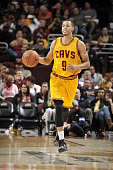 Jared Cunningham of the Cleveland Cavaliers brings the ball up court against the Dallas Mavericks on October 19 2015 at Quicken Loans Arena in...