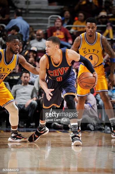 Jared Cunningham of the Cleveland Cavaliers defends the ball against the Golden State Warriors during the game on January 18 2016 at Quicken Loans...