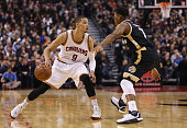 Jared Cunningham of the Cleveland Cavaliers dribbles the ball during an NBA game against the Toronto Raptors at the Air Canada Centre on November 25...