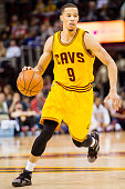Jared Cunningham of the Cleveland Cavaliers drives down court during the second half of a preseason game against the Dallas Mavericks at Quicken...