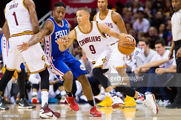 Jared Cunningham of the Cleveland Cavaliers drives past Isaiah Canaan of the Philadelphia 76ers during the first half at Quicken Loans Arena on...
