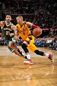 Jared Cunningham of the Cleveland Cavaliers drives to the basket during the game against the Milwaukee Bucks on November 19 2015 at Quicken Loans...