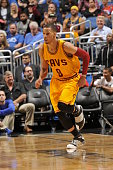 Jared Cunningham of the Cleveland Cavaliers drives to the basket against the Orlando Magic during the game on December 11 2015 at Amway Center in...